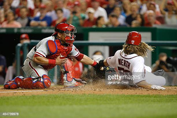 Catcher Carlos Ruiz of the Philadelphia Phillies tags out Jayson Werth of the Washington Nationals at the plate to end the seventh inning at...