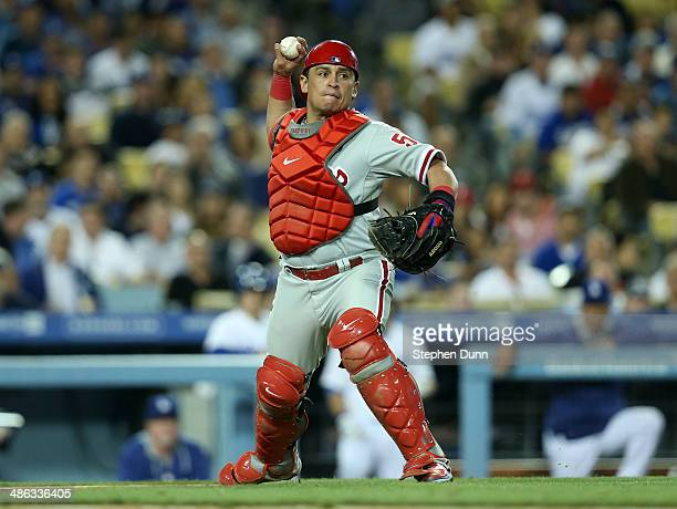 Catcher Carlos Ruiz of the Philadelphia Phillies throws to first for the out after fielding a ground ball hit by Scott Van Slyke of the Los Angeles...