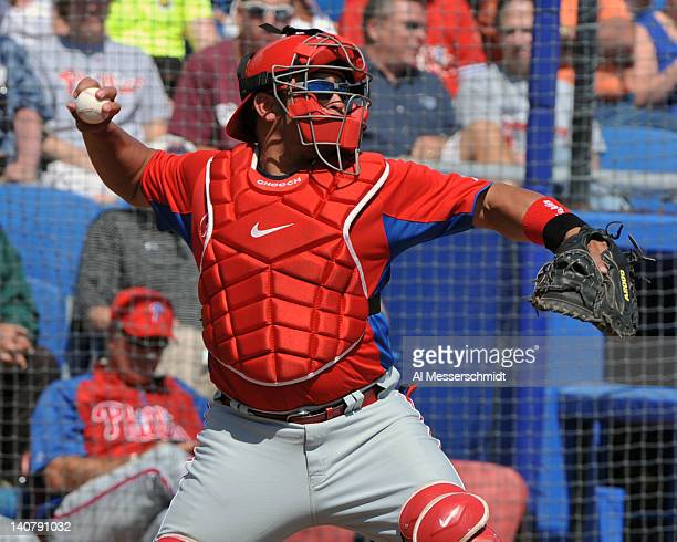 Catcher Carlos Ruiz of the Philadelphia Phillies throws to second base against the Toronto Blue Jays March 6 2012 at Florida Auto Exchange Stadium in...