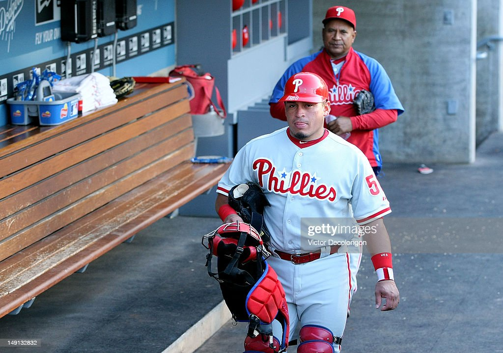 Catcher Carlos Ruiz #51 of the Philadelphia Phillies walks in the dugout prior to the MLB game against the Los Angeles Dodgers at Dodger Stadium on July 17, 2012 in Los Angeles, California. The Phillies defeated the Dodgers 3-2.