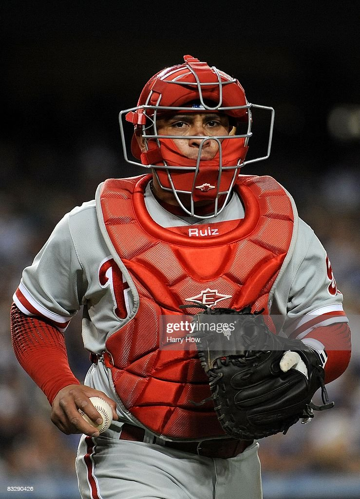 Catcher Carlos Ruiz of the Philadelphia Phillies walks off the field during Game Four of the National League Championship Series against the Los...