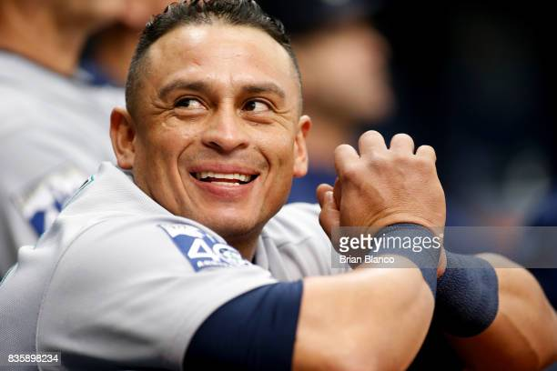 Catcher Carlos Ruiz of the Seattle Mariners looks on from the dugout during the first inning of a game against the Tampa Bay Rays on August 20 2017...