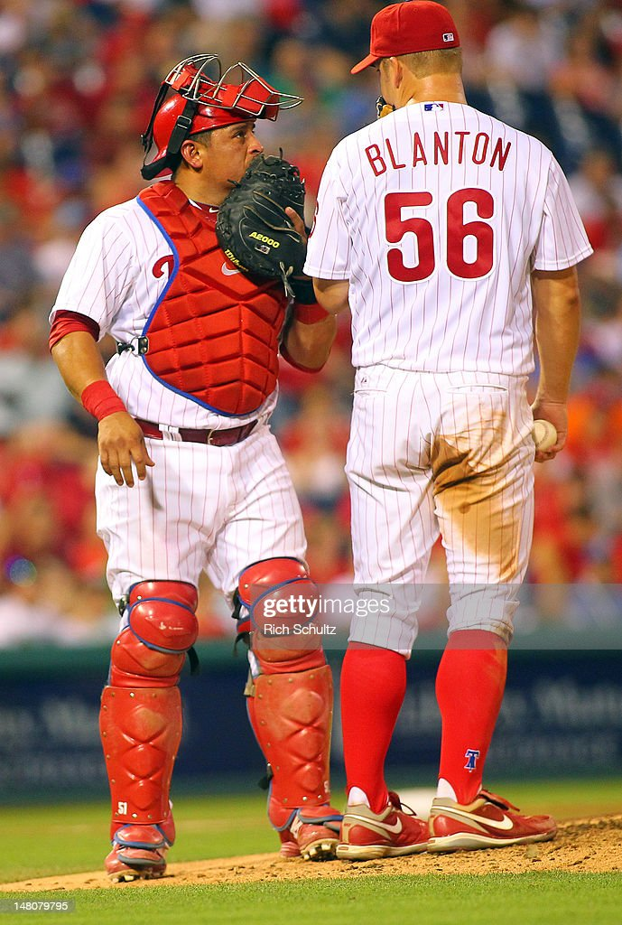 Catcher Carlos Ruiz #51 talks with pitcher Joe Blanton #56 of the Philadelphia Phillies during a MLB baseball game against the Atlanta Braves on July 7, 2012 at Citizens Bank Park in Philadelphia, Pennsylvania. The Braves defeated the Phillies 6-3.