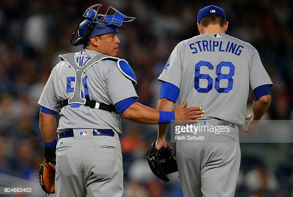 Catcher Carlos Ruiz talks with Ross Stripling of the Los Angeles Dodgers after giving up a home run to Didi Gregorius of New York Yankees during the...