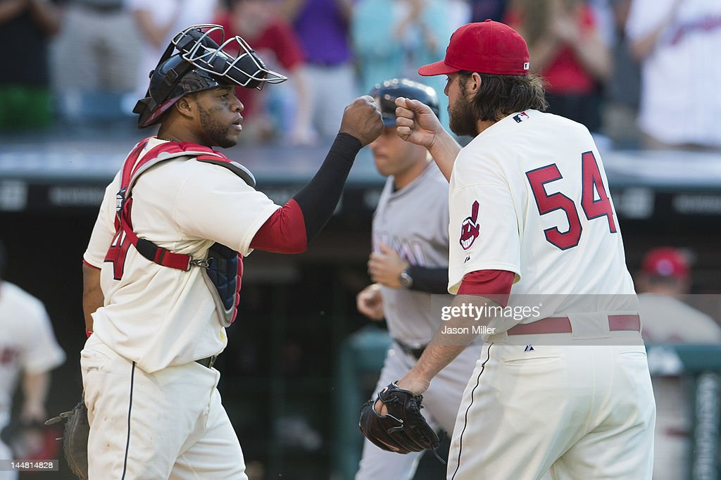 Catcher Carlos Santana #41 and closing pitcher Chris Perez #54 of the Cleveland Indians celebrates after striking out Greg Dobbs (not shown) #29 of the Miami Marlins to end the game at Progressive Field on May 19, 2012 in Cleveland, Ohio. The Indians defeated the Marlins 2-0.