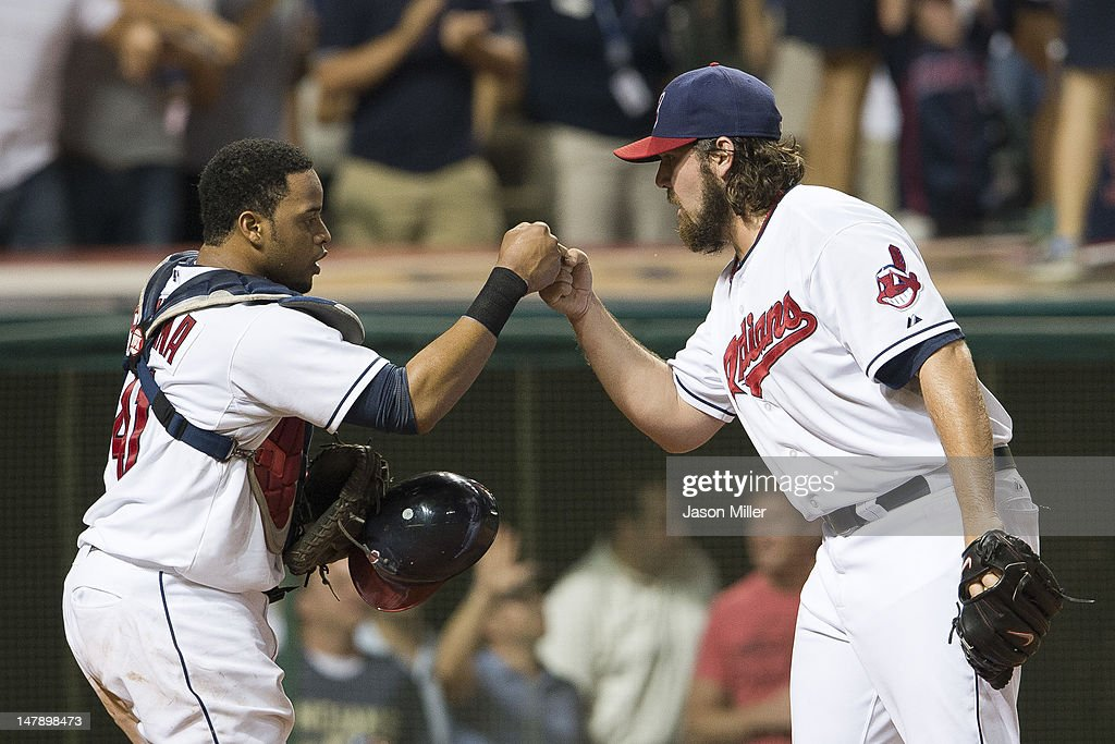 Catcher Carlos Santana #41 and closing pitcher Chris Perez #54 of the Cleveland Indians celebrate after the Indians defeated the Tampa Bay Rays at Progressive Field on July 5, 2012 in Cleveland, Ohio. The Indians defeated the Rays 3-1.