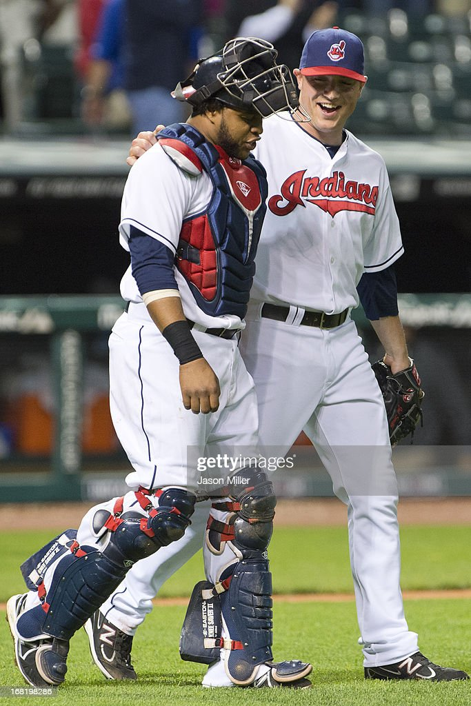 Catcher Carlos Santana #41 and closing pitcher Joe Smith #38 of the Cleveland Indians celebrate after the Indians defeated the Oakland Athletics at Progressive Field on May 6, 2013 in Cleveland, Ohio. The Indians defeated the Athletics 7-3.