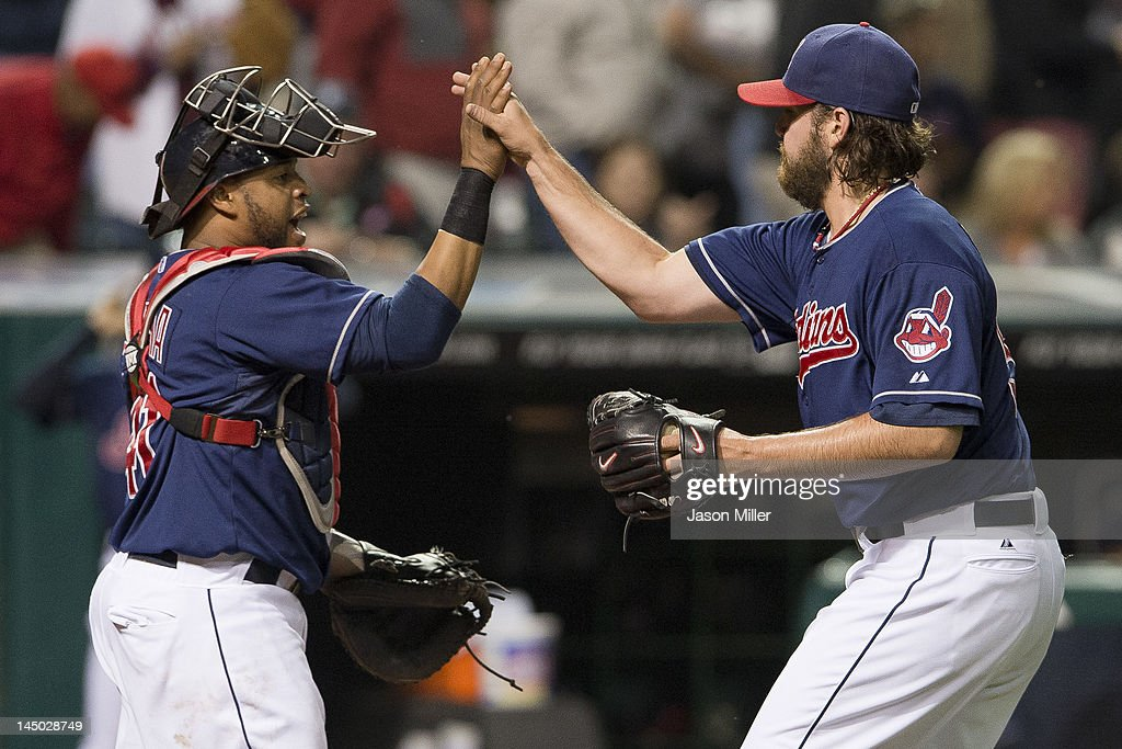 Catcher Carlos Santana #41 celebrates with closing pitcher Chris Perez #54 of the Cleveland Indians after they defeated the against the Detroit Tigers at Progressive Field on May 22, 2012 in Cleveland, Ohio. The Indians defeated the Tigers 5-3.