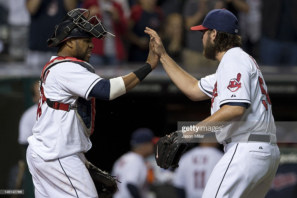 Catcher Carlos Santana #41 celebrates with closing pitcher Chris Perez #54 of the Cleveland Indians after the Indians defeated the Detroit Tigers at Progressive Field on May 23, 2012 in Cleveland, Ohio. The Indians defeated the Tigers 4-2.