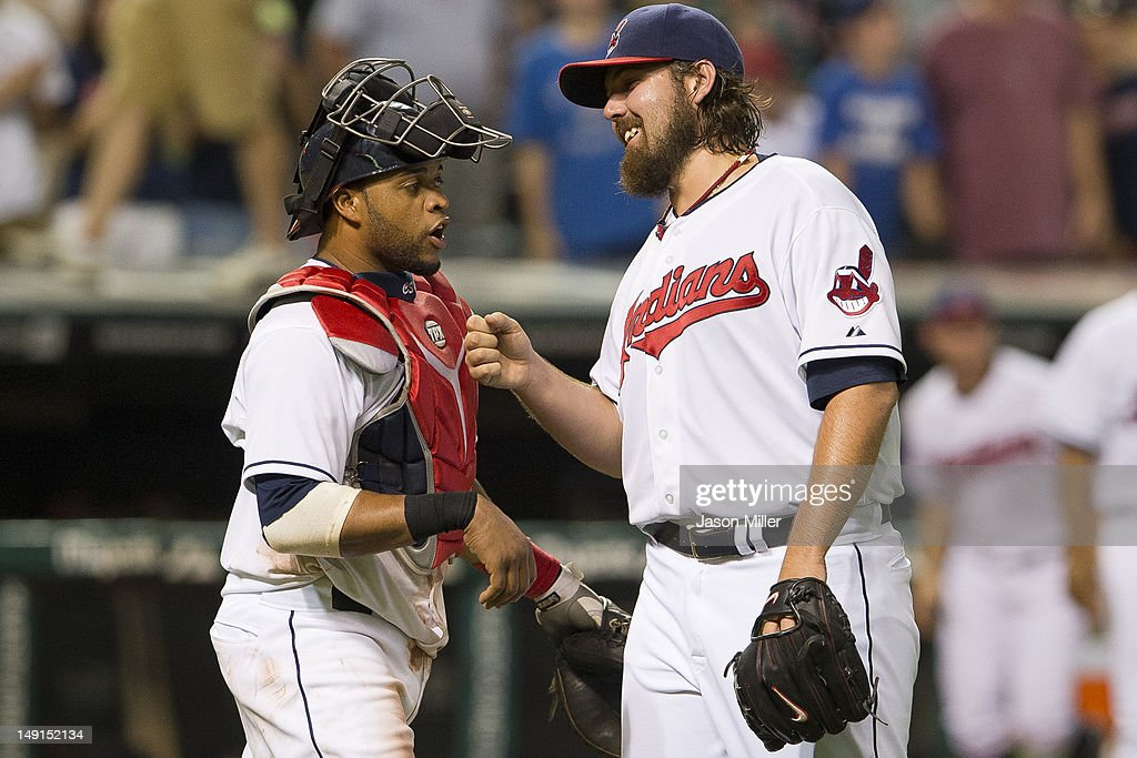 Catcher Carlos Santana #41 celebrates with closing pitcher Chris Perez #54 of the Cleveland Indians after the Indians defeated the Baltimore Orioles at Progressive Field on July 23, 2012 in Cleveland, Ohio. The Indians defeated the Orioles 3-1.