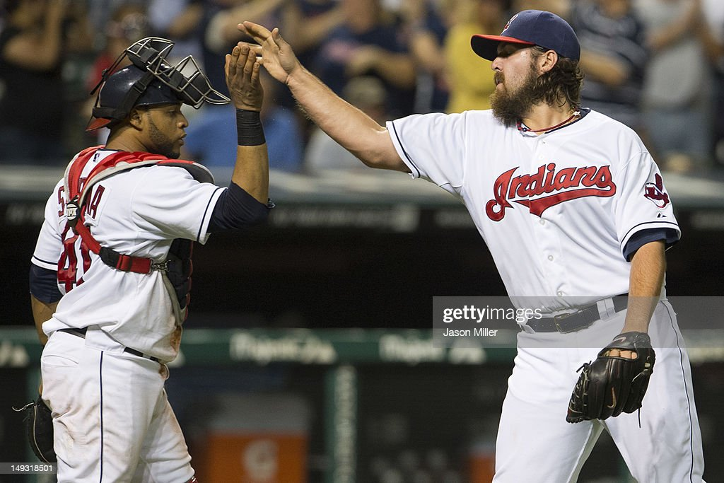 Catcher Carlos Santana #41 celebrates with closing pitcher Chris Perez #54 of the Cleveland Indians after the Indians defeated the Detroit Tigers at Progressive Field on July 26, 2012 in Cleveland, Ohio. The Indians defeated the Tigers 5-3.