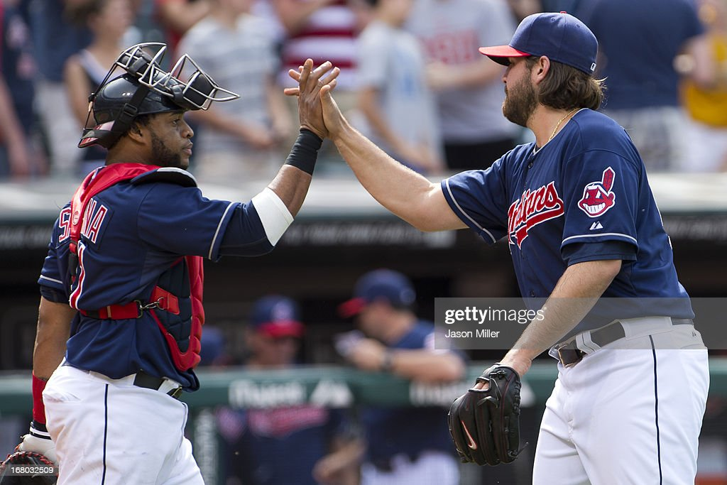 Catcher Carlos Santana #41 celebrates with closing pitcher Chris Perez #54 of the Cleveland Indians celebrates after the Indians defeated the Minnesota Twins at Progressive Field on May 4, 2013 in Cleveland, Ohio. The Indians defeated the Twins 7-3.