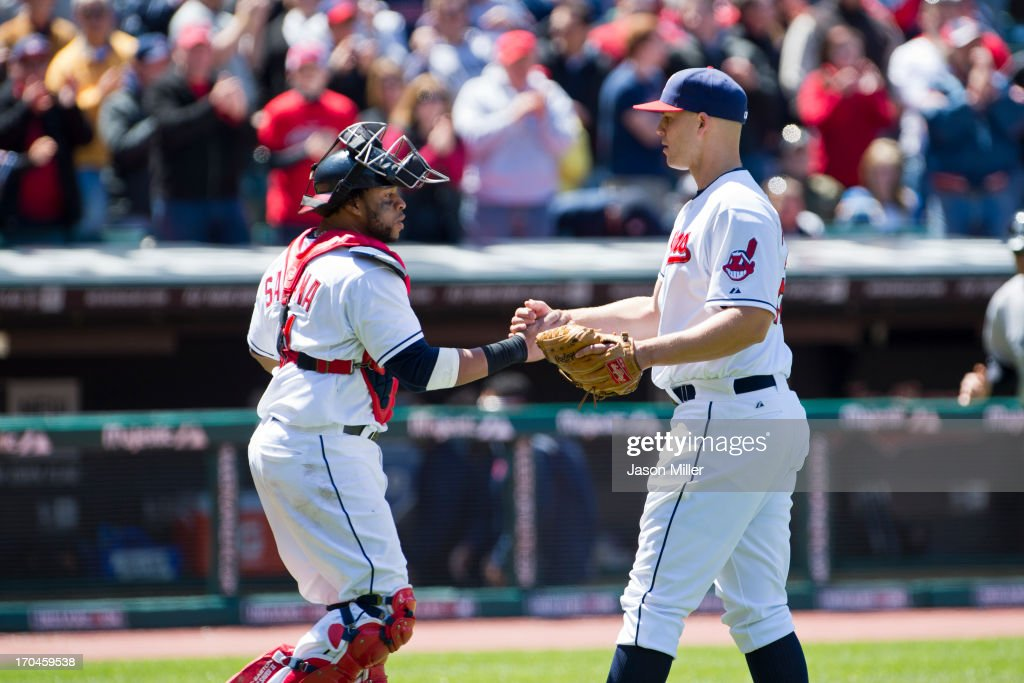 Catcher Carlos Santana #41 celebrates with starting pitcher <a gi-track='captionPersonalityLinkClicked' href=/galleries/search?phrase=Justin+Masterson&family=editorial&specificpeople=4950538 ng-click='$event.stopPropagation()'>Justin Masterson</a> #63 of the Cleveland Indians after the Indians defeated the New York Yankees during the first game of a doubleheader at Progressive Field on May 13, 2013 in Cleveland, Ohio. The Indians defeated the Yankees 1-0.