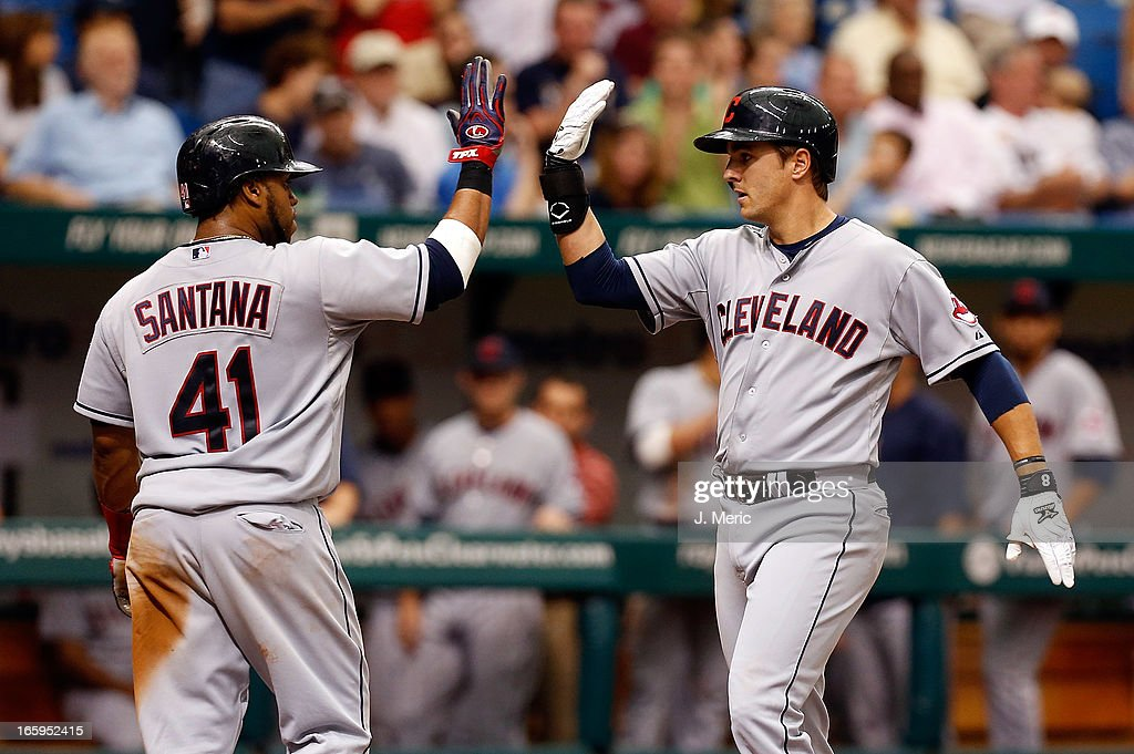 Catcher Carlos Santana #41 of the Cleveland Indians congratulates infielder <a gi-track='captionPersonalityLinkClicked' href=/galleries/search?phrase=Lonnie+Chisenhall&family=editorial&specificpeople=6796448 ng-click='$event.stopPropagation()'>Lonnie Chisenhall</a> #8 after his fifth inning home run against of the Tampa Bay Rays during the game at Tropicana Field on April 7, 2013 in St. Petersburg, Florida.