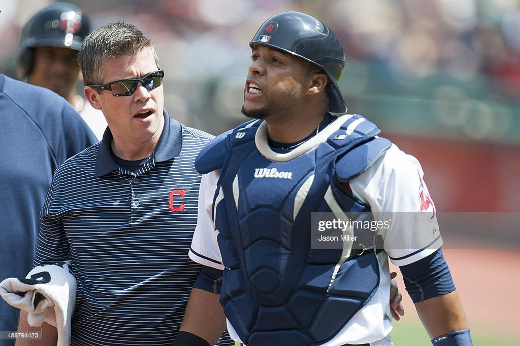 Catcher Carlos Santana #41 of the Cleveland Indians grimaces after being hit by a foul tip during the second inning against the Minnesota Twins at Progressive Field on May 8, 2014 in Cleveland, Ohio.