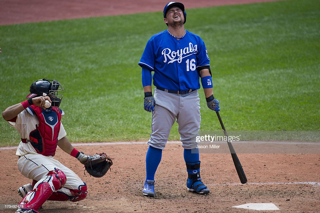 Catcher Carlos Santana #41 of the Cleveland Indians returns the pitch as <a gi-track='captionPersonalityLinkClicked' href=/galleries/search?phrase=Billy+Butler&family=editorial&specificpeople=759092 ng-click='$event.stopPropagation()'>Billy Butler</a> #16 of the Kansas City Royals reacts after being being called out looking during the ninth inning at Progressive Field on July 14, 2013 in Cleveland, Ohio. The Indians defeated the Royals 6-4.