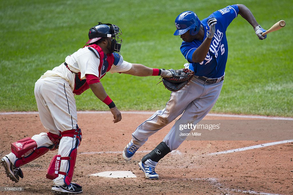 Catcher Carlos Santana #41 of the Cleveland Indians tags out <a gi-track='captionPersonalityLinkClicked' href=/galleries/search?phrase=Lorenzo+Cain&family=editorial&specificpeople=5746615 ng-click='$event.stopPropagation()'>Lorenzo Cain</a> #6 of the Kansas City Royals to end the top of the seventh inning at Progressive Field on July 14, 2013 in Cleveland, Ohio. The Indians defeated the Royals 6-4.