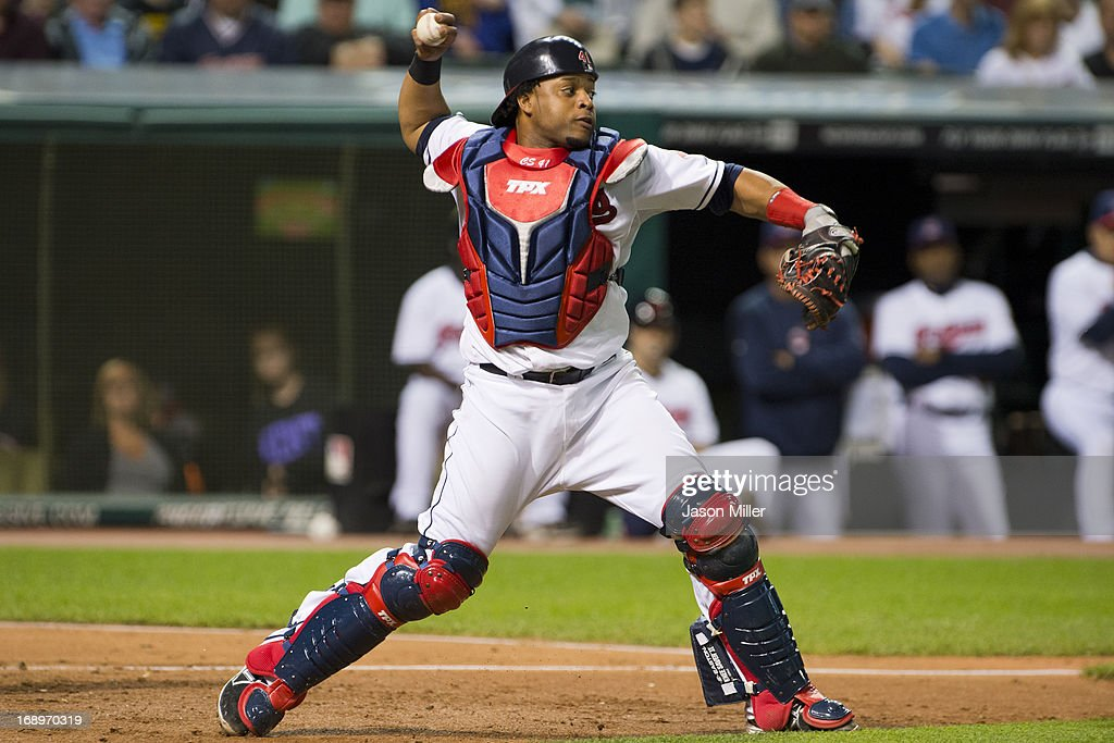 Catcher Carlos Santana #41 of the Cleveland Indians throws to second base during the seventh inning against the Seattle Mariners at Progressive Field on May 17, 2013 in Cleveland, Ohio.