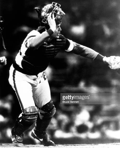 Catcher Carlton Fisk of the Chicago White Sox looks to field the ball during an MLB game circa 1982 at Comiskey Park in Chicago Illinois
