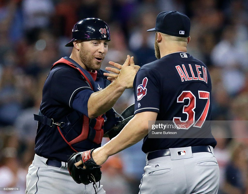 Catcher <a gi-track='captionPersonalityLinkClicked' href=/galleries/search?phrase=Chris+Gimenez&family=editorial&specificpeople=4959066 ng-click='$event.stopPropagation()'>Chris Gimenez</a> #38 of the Cleveland Indians celebrates wth pitcher Cody Allen #37 of the Cleveland Indians after a 7-4 win over the Detroit Tigers at Comerica Park on June 24, 2016 in Detroit, Michigan.