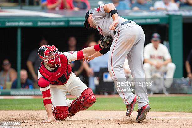 Catcher Chris Gimenez of the Cleveland Indians tags out Travis Shaw of the Boston Red Sox at home to end the top of the third inning at Progressive...