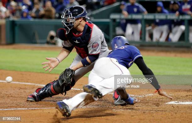 Catcher Chris Gimenez of the Minnesota Twins is late with tag on Delino DeShields of the Texas Rangers as he scores on a tworun double off the bat of...