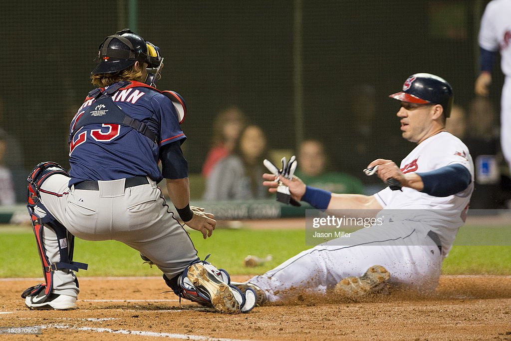 Catcher Chris Herrmann #23 of the Minnesota Twins tags out <a gi-track='captionPersonalityLinkClicked' href=/galleries/search?phrase=Travis+Hafner&family=editorial&specificpeople=220556 ng-click='$event.stopPropagation()'>Travis Hafner</a> #48 of the Cleveland Indians during the fourth inning at Progressive Field on September 19, 2012 in Cleveland, Ohio.