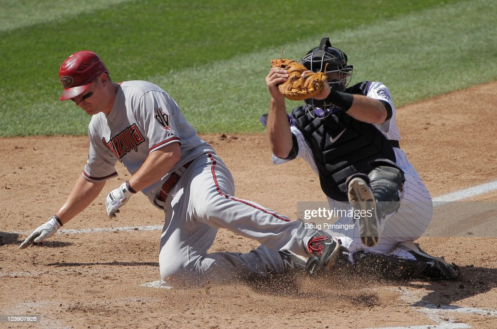 Catcher Chris Iannetta #20 of the Colorado Rockies tags out Geoff Blum #27 of the Arizona Diamondbacks at home as he tried to score on a bunt by Wade Miley #36 of the Arizona Diamondbacks in the fourth inning at Coors Field on September 5, 2011 in Denver, Colorado.