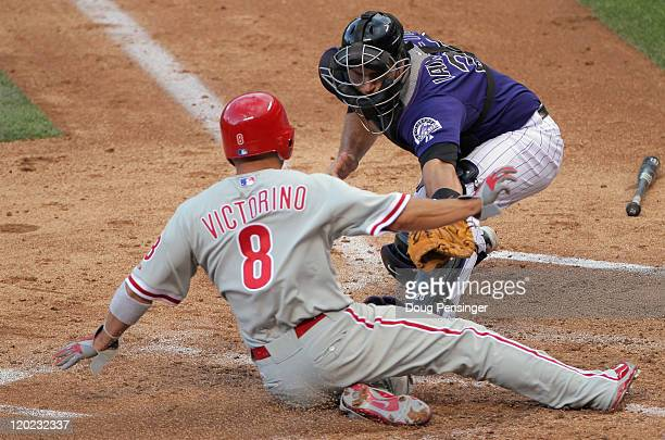 Catcher Chris Iannetta of the Colorado Rockies tags out Shane Victorino of the Philadelphia Phillies as he tried to score on a single by Chase Utley...