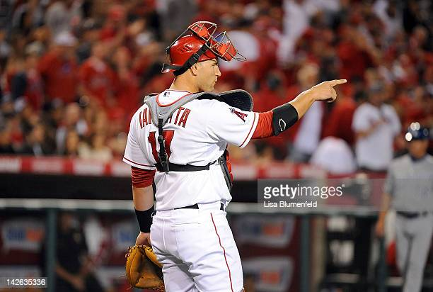 Catcher Chris Iannetta of the Los Angeles Angels of Anaheim points to pitcher Jered Weaver during the game against the Kansas City Royals at Angel...