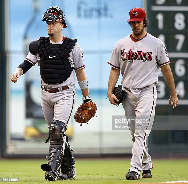 Catcher Chris Snyder and pitcher Dan Haren of the Arizona Diamondbacks make their way in from the bullpen after pregame warm ups before the Arizona...