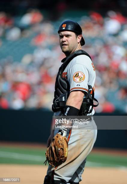 Catcher Chris Snyder of the Baltimore Orioles looks on during the game against the Los Angeles Angels of Anaheim at Angel Stadium of Anaheim on May 4...