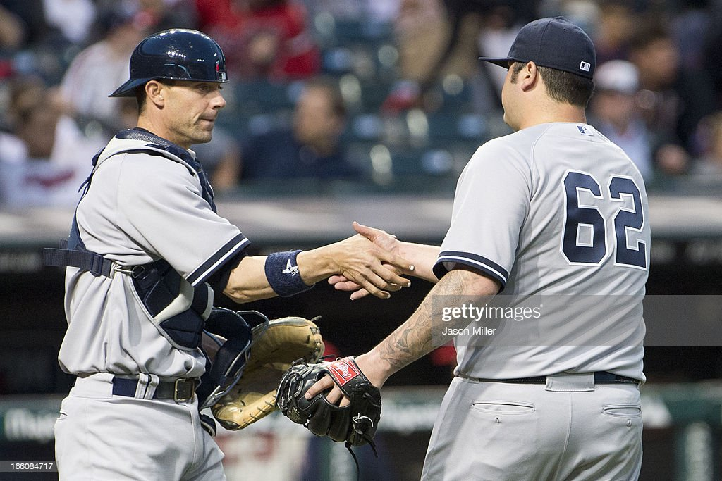 Catcher Chris Stewart #19 of the New York Yankees celebrates with <a gi-track='captionPersonalityLinkClicked' href=/galleries/search?phrase=Joba+Chamberlain&family=editorial&specificpeople=4391682 ng-click='$event.stopPropagation()'>Joba Chamberlain</a> #62 after defeating the Cleveland Indians on opening day at Progressive Field on April 8, 2013 in Cleveland, Ohio. The Yankees defeated the Indians 11-6.