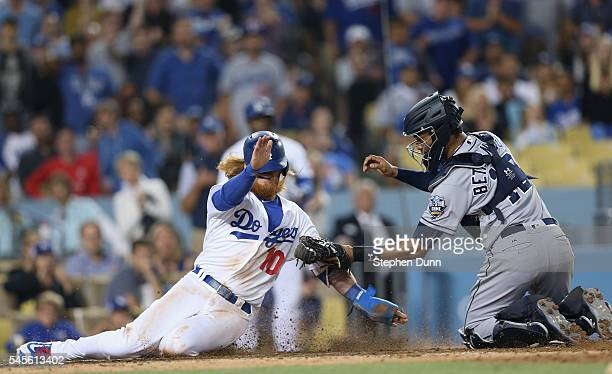 Catcher Christian Bethancourt of the San Diego Padres tags out Justin Turner of the Los Angeles Dodgers at home in the sixth inning at Dodger Stadium...