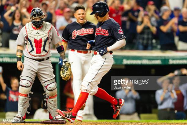 Catcher Christian Vazquez of the Boston Red Sox watches as Brandon Guyer of the Cleveland Indians scores on a sacrifice bunt by Roberto Perez of the...