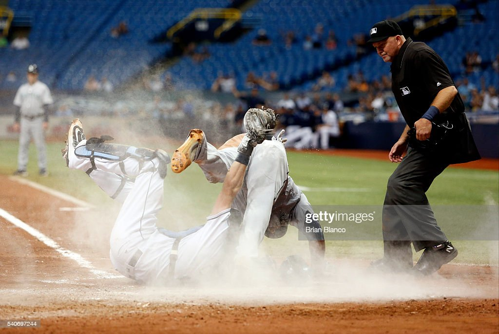 Catcher Curt Casali #19 of the Tampa Bay Rays gets the out at home plate on <a gi-track='captionPersonalityLinkClicked' href=/galleries/search?phrase=Chris+Iannetta&family=editorial&specificpeople=836137 ng-click='$event.stopPropagation()'>Chris Iannetta</a> #33 of the Seattle Mariners to end the top of the seventh inning of a game on June 16, 2016 at Tropicana Field in St. Petersburg, Florida.