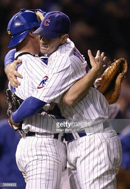 Catcher Damian Miller and starting picther Mark Prior opf the Chicago Cubs celebrate their 31 win over the Atlanta Braves during game three of the...