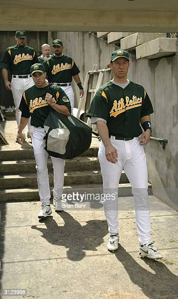 Catcher Damian Miller of the Oakland A's right leads teammates onto the field prior to taking on the Milwaukee Brewers on March 5 2004 at Phoenix...