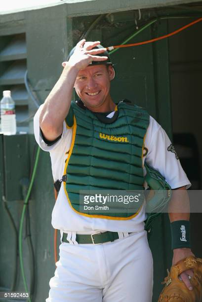 Catcher Damian Miller of the Oakland A's watches fromthe dugout during the game against the Cleveland Indians at the Network Associates Coliseum on...