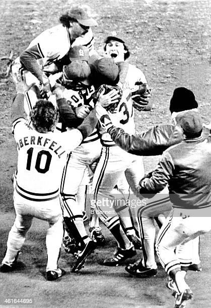 Catcher Darrell Porter Ken Oberkfell and Keith Hernandez of the St Louis Cardinals mob pitcher Bruce Sutter after the Cardinals defeated the...