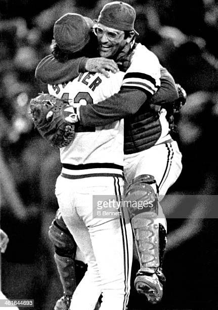 Catcher Darrell Porter of the St Louis Cardinals jumps into the arms of pitcher Bruce Sutter after the Cardinals defeated the Milwaukee Brewers in...