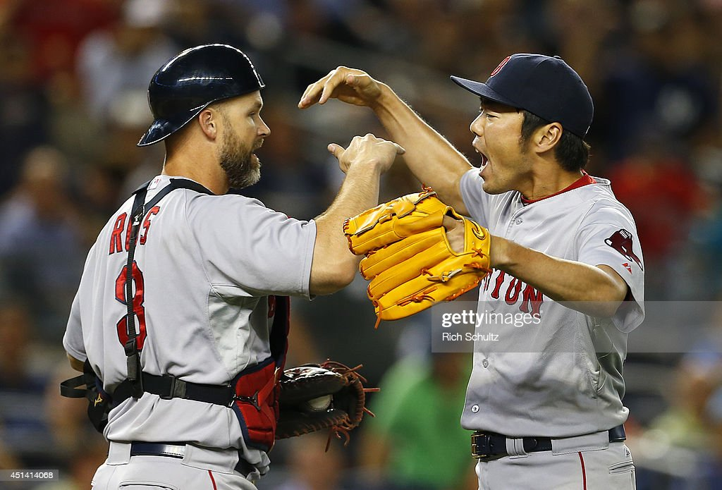 Catcher David Ross #3 congratulates Koji Uehara #19 of the Boston Red Sox after defeating the New York Yankees 2-1 in a game at Yankee Stadium on June 28, 2014 in the Bronx borough of New York City.