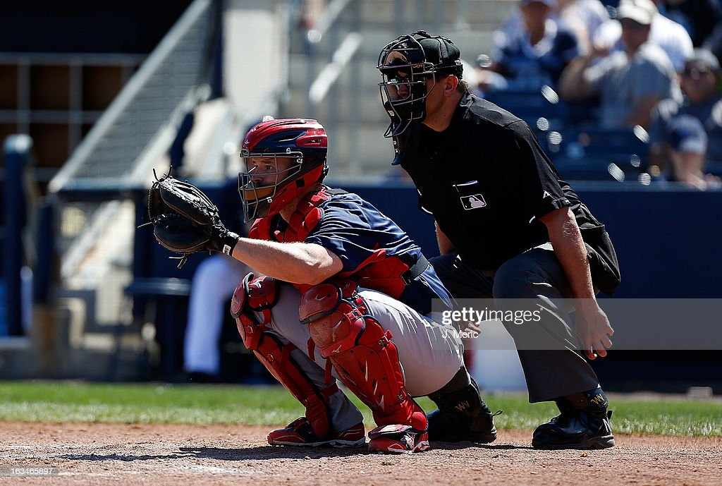 Catcher <a gi-track='captionPersonalityLinkClicked' href=/galleries/search?phrase=David+Ross&family=editorial&specificpeople=210843 ng-click='$event.stopPropagation()'>David Ross</a> #3 of the Boston Red Sox catches against the Tampa Bay Rays during a Grapefruit League Spring Training Game at the Charlotte Sports Complex on March 10, 2013 in Port Charlotte, Florida.