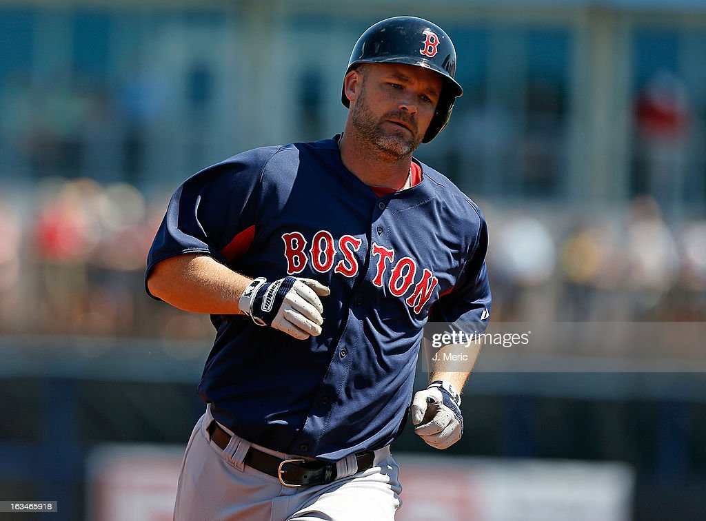 Catcher <a gi-track='captionPersonalityLinkClicked' href=/galleries/search?phrase=David+Ross&family=editorial&specificpeople=210843 ng-click='$event.stopPropagation()'>David Ross</a> #3 of the Boston Red Sox rounds the bases after his fourth inning three run home run against the Tampa Bay Rays during a Grapefruit League Spring Training Game at the Charlotte Sports Complex on March 10, 2013 in Port Charlotte, Florida.