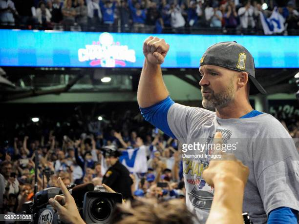 Catcher David Ross of the Chicago Cubs is carried off the field by teammates after winning Game 7 of the World Series against the Cleveland Indians...