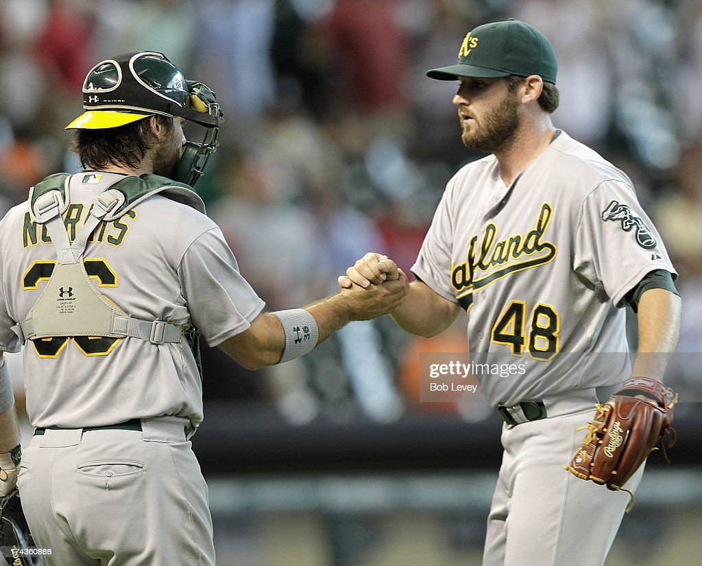 Catcher Derek Norris #36 of the Oakland Athletics shakes hands with pitcher Ryan Cook #48 after the final out against the Houston Astros at Minute Maid Park on July 24, 2013 in Houston, Texas.