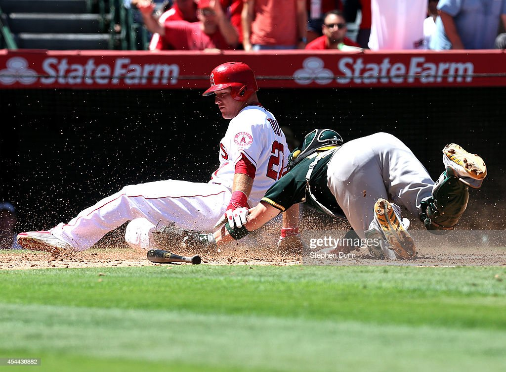 Catcher <a gi-track='captionPersonalityLinkClicked' href=/galleries/search?phrase=Derek+Norris&family=editorial&specificpeople=6795804 ng-click='$event.stopPropagation()'>Derek Norris</a> #36 of the Oakland Athletics tags out <a gi-track='captionPersonalityLinkClicked' href=/galleries/search?phrase=Mike+Trout&family=editorial&specificpeople=7091306 ng-click='$event.stopPropagation()'>Mike Trout</a> #27 of the Los Angeles Angels of Anaheim at home for the final out of the second inning at Angel Stadium of Anaheim on August 31, 2014 in Anaheim, California.
