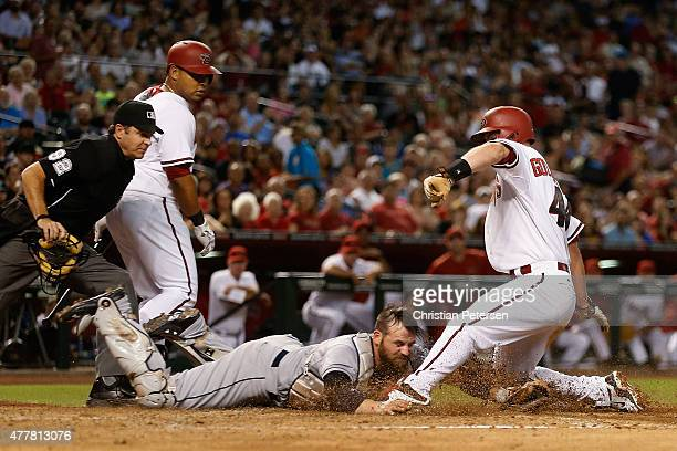Catcher Derek Norris of the San Diego Padres tags out Paul Goldschmidt of the Arizona Diamondbacks as he attempts to score a run during the third...