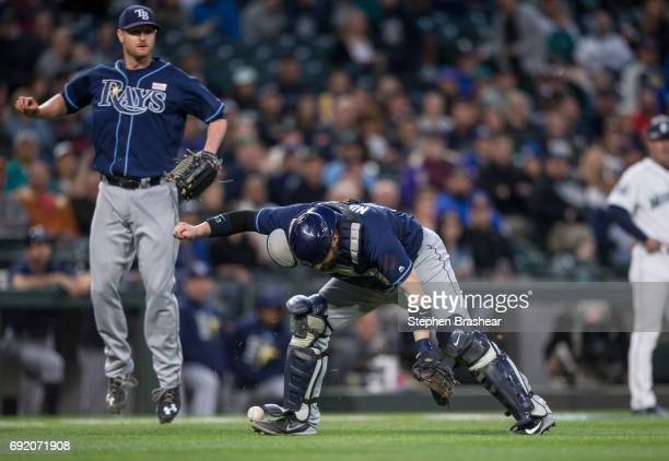 Catcher Derek Norris of the Tampa Bay Rays cannot handle a bunt by Jarrod Dyson of the Seattle Mariners during the fifth inning of a game at Safeco...