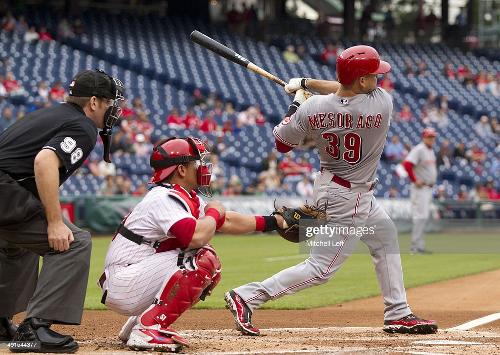 Catcher <a gi-track='captionPersonalityLinkClicked' href=/galleries/search?phrase=Devin+Mesoraco&family=editorial&specificpeople=5745587 ng-click='$event.stopPropagation()'>Devin Mesoraco</a> #39 of the Cincinnati Reds hits a three run home run in the top of the first inning against the Philadelphia Phillies on May 16, 2014 at Citizens Bank Park in Philadelphia, Pennsylvania.